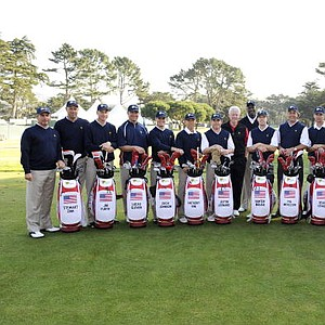 Members of the U.S. Team pose with former U.S. President Bill Clinton and Michael Jordan on the practice ground prior to the start of The Presidents Cup at Harding Park Golf Club in 2009.