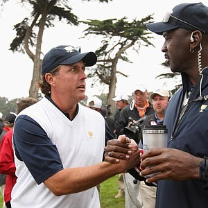 Phil Mickelson of the USA Team chats with Michael Jordan, a USA Team assistant during the Day Three Morning Foursomes of The Presidents Cup at Harding Park GC.
