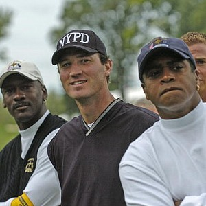 Amhad Rashad, Mario Lemieux and Michael Jordan watch four-ball competition at the 2004 Ryder Cup in Detroit, Mich.