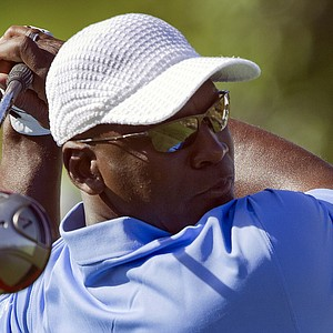 Former basketball player Michael Jordan tees off on the first hole during the Michae Jordan Invitational celebrity golf tournament.