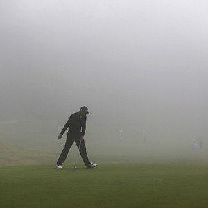 Sergio Garcia rolls in a birdie putt on the eighth green, as thick fog rolls in during the first round of the Northern Trust Open golf at Riviera Country Club in the Pacific Palisades area of Los Angeles on Thursday, Feb. 14, 2013.