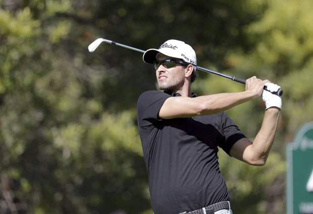 Adam Scott tees off on the fourth hole during the first round of the Northern Trust Open at Riviera Country Club in the Pacific Palisades area of Los Angeles Thursday, Feb. 14, 2013.