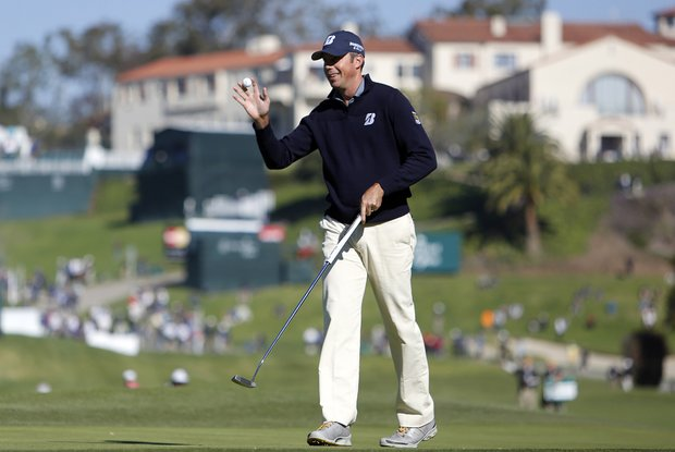 Matt Kuchar waves after making a birdie on the 10th green during the first round of the Northern Trust Open at Riviera Country Club in the Pacific Palisades area of Los Angeles Thursday, Feb. 14, 2013.