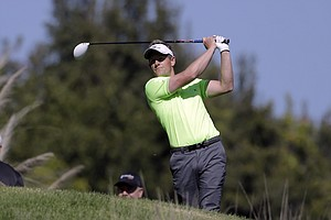 Luke Donald drives off the fifth tee during the first round of the Northern Trust Open at Riviera Country Club in the Pacific Palisades area of Los Angeles Thursday, Feb. 14, 2013.