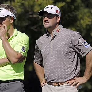Luke Donald, left, and Graeme McDowell wait to tee off on the fourth hole in the first round of the Northern Trust Open at Riviera Country Club in the Pacific Palisades area of Los Angeles, Thursday, Feb. 14, 2013.