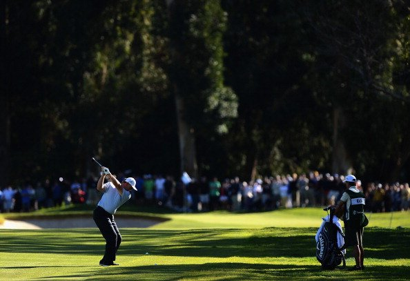 Ernie Els of South Africa hits a second shot on the first hole during the third round of the Northern Trust Open at the Riviera CC in Pacific Palisades, Calif.