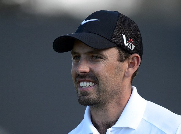 Charl Schwartzel of South Africa reacts as he leaves the first green after a birdie during the third round of the Northern Trust Open at the Riviera Country Club on February 16, 2013 in Pacific Palisades, Calif.