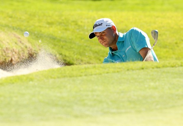 Bill Haas hits out of a bunker on the 17th hole during the third round of the Northern Trust Open. Haas opened a three-shot advantage behind a 7-under 64 on Saturday.