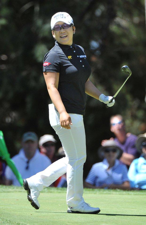 Jiyai Shin fired a 1-under 72 to win the Australian Open by two shots over Yani Tseng.