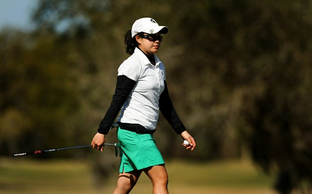Paveenuch Sritragul of Michigan State walks off the green at No. 9 during the Central District tournament.