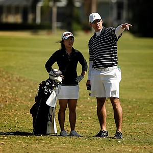 Vanderbilt head coach Greg Allen talks with Jenny Hahn during the Central District tournament at River Wilderness in Parrish.