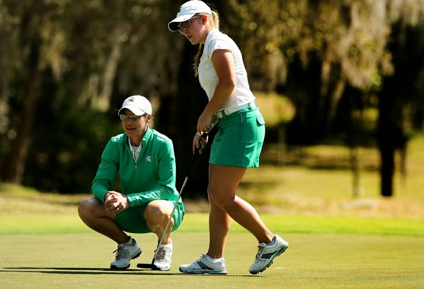 Michigan State's Caroline Powers with head coach Stacy Slobodnik-Stoll during the Central District tournament at River Wilderness in Parrish.