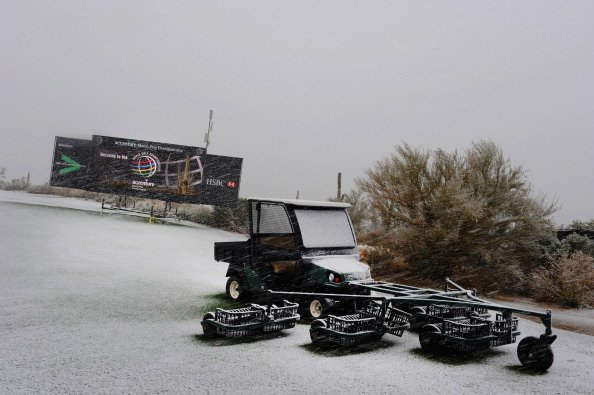 Snow continues to fall on the practice range as snow and rain caused play to be suspended due to weather during the first round of the World Golf Championships-Accenture Match Play Championship in Marana, Ariz.