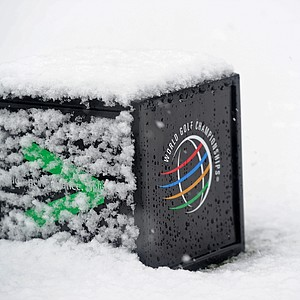 A detail of a tee box marker covered with snow as play was suspended during the first round of the WGC-Accenture Match Play Championship.