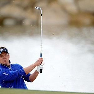 Luke Donald hits a shot out of the bunker on the third hole during the first round of the World Golf Championships-Accenture Match Play at the Golf Club at Dove Mountain on February 21, 2013 in Marana, Ariz.