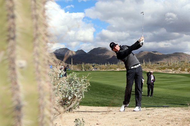 Rory McIlroy hits his second shot on the second hole during the first round of the World Golf Championships-Accenture Match Play at the Golf Club at Dove Mountain on February 21, 2013 in Marana, Ariz.