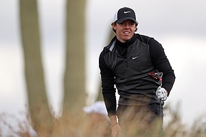Rory McIlroy watches his tee shot on the second hole during the first round of the World Golf Championships-Accenture Match Play at the Golf Club at Dove Mountain on February 21, 2013 in Marana, Ariz.