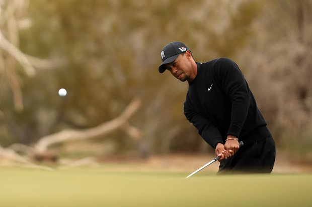 Tiger Woods hits a chip shot on the eighth hole during the first round of the World Golf Championships-Accenture Match Play at the Golf Club at Dove Mountain on February 21, 2013 in Marana, Ariz.