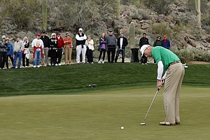 Jim Furyk putts on the 11th green in the first round of play against Ryan Moore during the WGC-Accenture Match Play Championship, Thursday, Feb. 21, 2013, in Marana, Ariz.