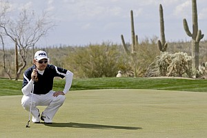 South Africa's Louis Oosthuizen lines up a putt on the seventh green during the WGC-Accenture Match Play Championship, Thursday, Feb. 21, 2013, in Marana, Ariz.