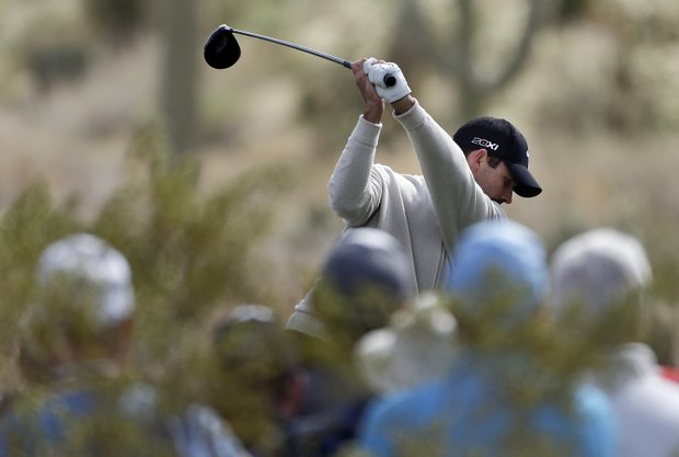 Charl Schwartzel tees off of the 17th hole during a first round against Russell Henley at the WGC-Accenture Match Play Championship, Thursday, Feb. 21, 2013, in Marana, Ariz.