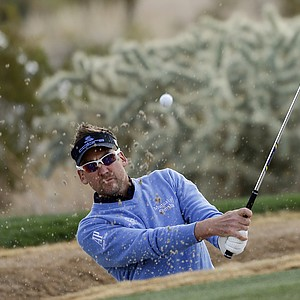 Ian Poulter hits out of a bunker onto the 16th green during the first round of the WGC-Accenture Match Play Championship, Thursday, Feb. 21, 2013, in Marana, Ariz.