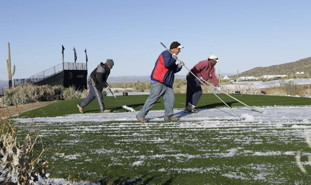From left, grounds keepers Erick Montano, Tony Lange and Leslie Wofford clear snow off the 10th tee for the WGC-Accenture Match Play Championship, Thursday, Feb. 21, 2013, in Marana, Ariz.