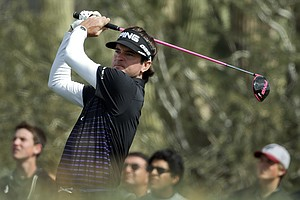 Bubba Watson tees off on the 11th hole during a first round match against Chris Wood at the WGC-Accenture Match Play Championship, Thursday, Feb. 21, 2013, in Marana, Ariz.
