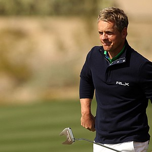 Luke Donald reacts after he lost his second-round match to Scott Piercy, 7 and 6, at the WGC-Accenture Match Play.