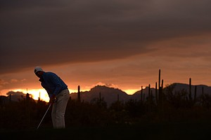 Matt Kuchar gets set to hit s shot on the first hole during the semifinal round of the World Golf Championships - Accenture Match Play at the Golf Club at Dove Mountain on February 24, 2013 in Marana, Arizona.