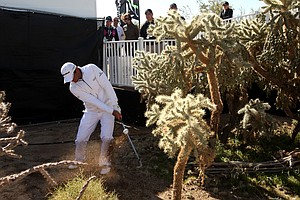 Jason Day hits a shot after taking a drop behind the 13th hole green during the semifinal round of the WGC-Accenture Match Play Championship.