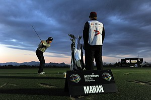 Hunter Mahan hits a shot on the driving range before the start of the semifinal round of the WGC-Accenture Match Play Championship.