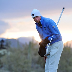 Matt Kuchar studies his putt on the first hole during the semifinal round of the WGC-Accenture Match Play Championship.