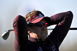 Ian Poulter reacts after he hit his third shot on the eighth hole during the semifinal round of the WGC-Accenture Match Play Championship.