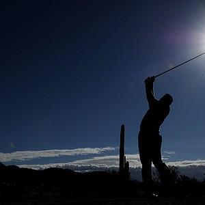 Hunter Mahan hits his tee shot on the ninth hole during the semifinal round of the WGC-Accenture Match Play Championship.