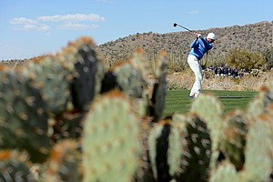 Matt Kuchar hits his tee shot on the ninth hole during the final round of the WGC-Accenture Match Play Championship.