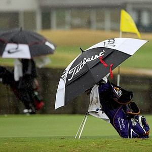 LSU's Smylie Kaufman puts on his rain gear at No. 9 during the John Hayt Invitational at Sawgrass Country Club. The tournament was called due to weather.