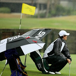 Marco Scarola of North Texas tries to keep somewhat dry during the John Hayt Invitational at Sawgrass Country Club.