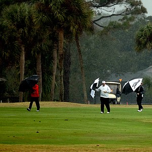 Players and spectators make their way to the clubhouse as called was played during the John Hayt Invitational at Sawgrass Country Club.