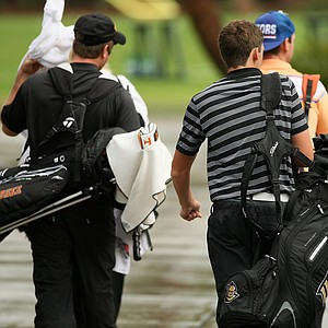 Players leave after play was halted during the John Hayt Invitational at Sawgrass Country Club.