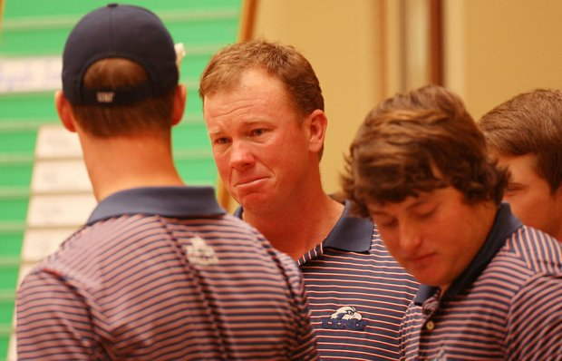 University of North Florida head coach Scott Schroeder gets emotional accepting the trophy after being declared the team winner at the John Hayt Invitational. Schroeder tried to contain his emotions when talking about John Hayt who is fighting cancer.
