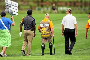 The Baltimore Ravens' Ed Reed, second from left, with a soldier from the Birdies For the Brave during the Honda Classic Pro-Am.