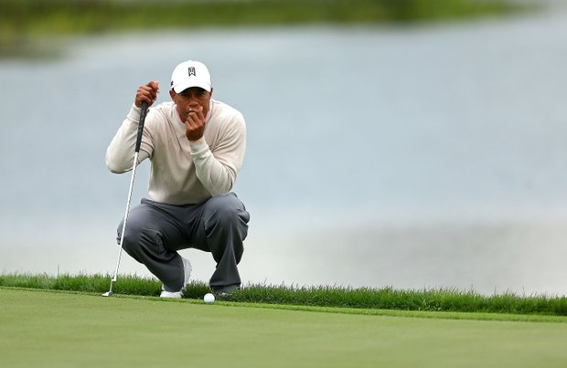 Tiger Woods putts on the fourth hole during the first round of the Honda Classic at PGA National.