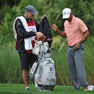 Tiger Woods prepares to hit a shot out of the water on No. 6 during the first round of the Honda Classic in Palm Beach Gardens, Fla.