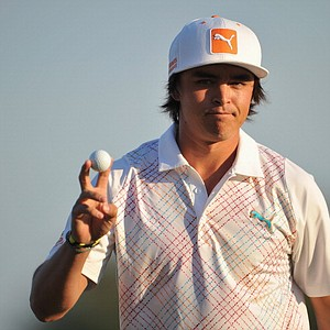 Rickie Fowler celebrates his putt on the 18th hole during the first round of the Honda Classic on Feb 28.