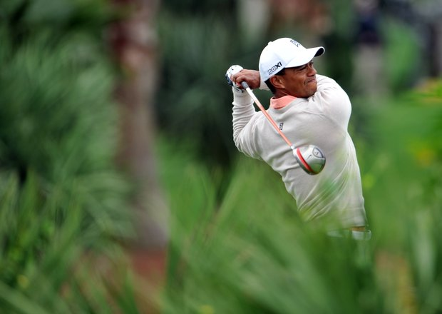 Tiger Woods will start his second round on the current cut line. He has missed one cut in 2013 already, at his season-opening appearance in Abu Dhabi.