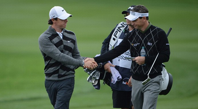 Rory McIlroy (left), the world's top-ranked player and the defending champion at the Honda Classic, tells playing competitor Mark Wilson that he has had enough Friday on their ninth hole, No. 18 at PGA National's Champion Course, during the second round.