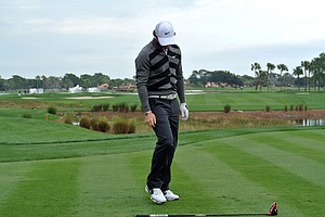 World No. 1 and defending champion, Rory McIlroy looks at his club on the 18th hole. He'd withdraw minutes later.