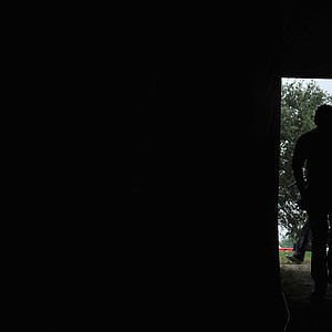 World No. 1 and defending champion, Rory McIlroy walks through a dark tunnel on the 16th hole where he took a triple bogey.