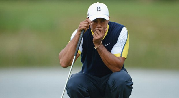 Tiger Woods ponders a putt on the eighth hole during the second round of the Honda Classic on March 1 in Palm Beach Gardens, Fla.